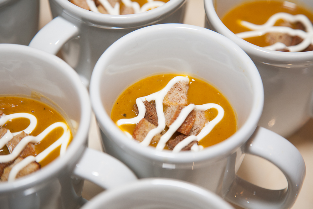 Curried pumpkin and mushroom soup with bagel croutons and sour cream