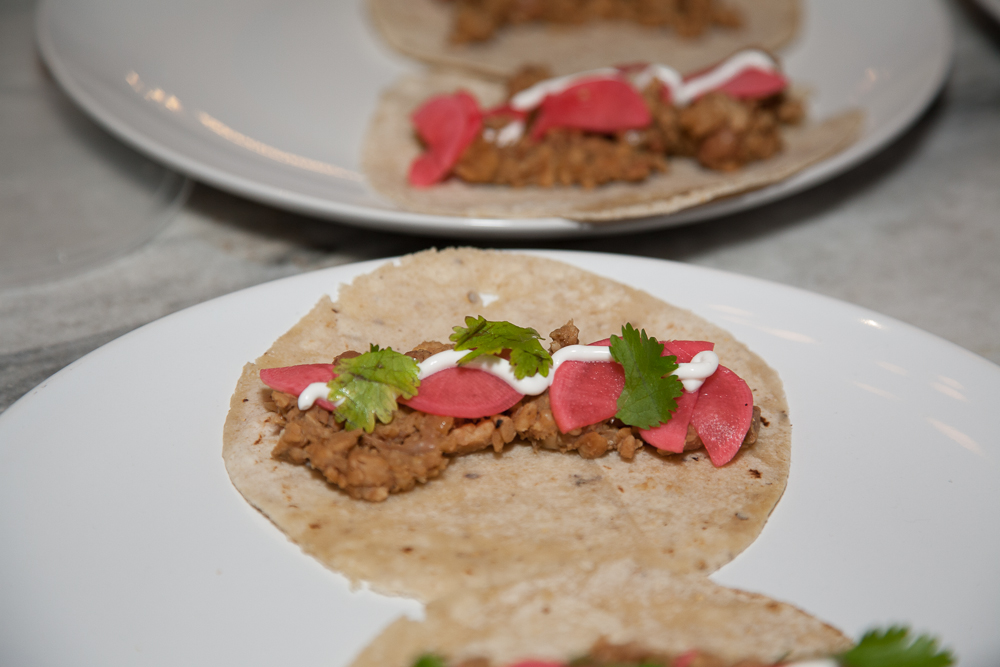 Lamb tacos with fresh pickled radishes and onions; served with blue potato hash and beet slaw
