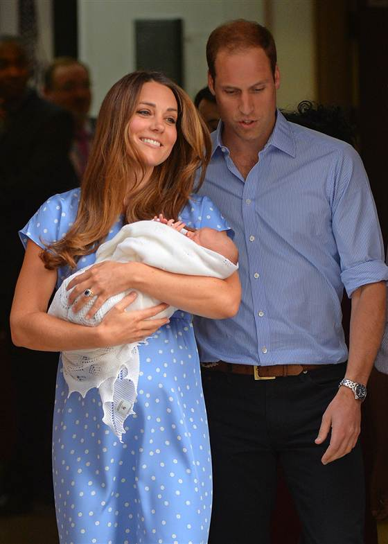 Duchess Kate, clad in a dress designed by British designer Jenny Packham, shows off her newborn son on Tuesday.