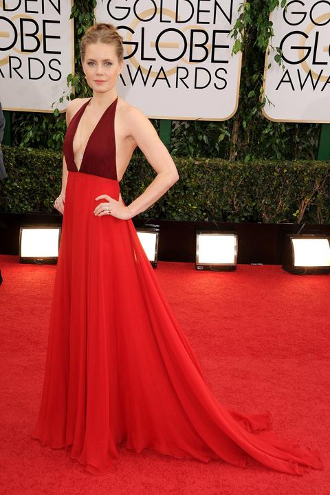 """Photo by: Getty Images    Best: Amy Adams  Red on a redhead is always a good move, and this two-tone Valentino halter is as sexy and award-winning as the """"American Hustle"""" best actress."""