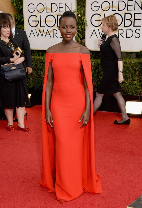 """Photo by: Getty Images    Best: Lupita Nyong'o  The """"12 Years a Slave"""" nominee won the red carpet in this stunning Ralph Lauren cape dress. Welcome to the big time, Lupita. We look forward to watching you throughout award season."""