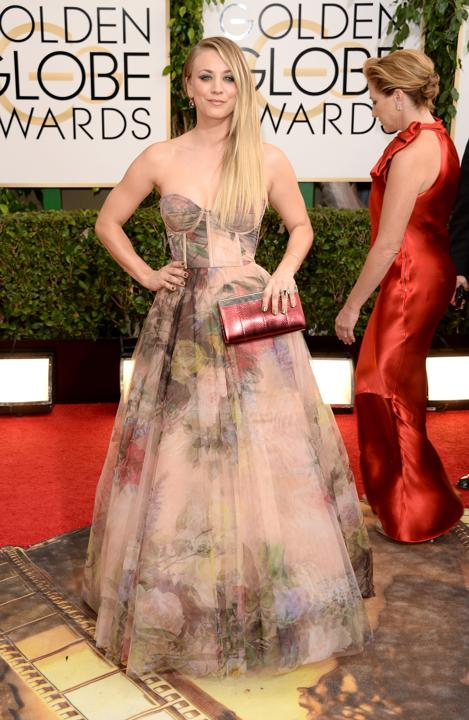 Photo by: Getty Images    Worst: Kaley Cuoco  Her Rani Zakhem distorted floral gown and metallic clutch looked like a cheap, punk prom outfit.