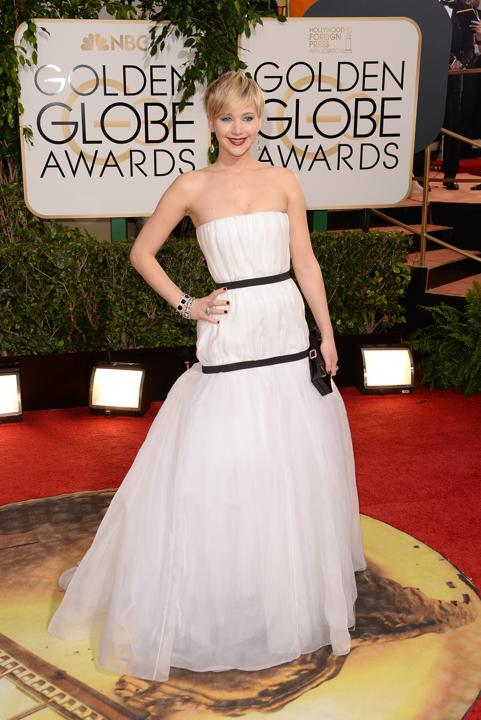 "Photo by: Getty Images    Worst: Jennifer Lawrence   Being locked in to an exclusive contract with Dior means the ""American Hustle"" best supporting actress winner may be stuck wearing lots more dull, pale-colored gowns throughout award season. This one looks like a crinoline with oddly placed harnesses."