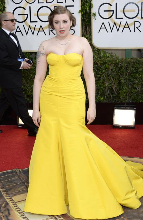 """Photo by: Getty Images    Worst: Lena Dunham  The """"Girls"""" actress keeps wearing yellow on the red carpet, but it's not her best color. Likewise, the silhouette seemed to highlight the wrong areas and hide her great legs."""