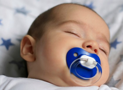 Sleeping baby withpacifier.
