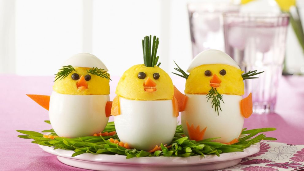 "In this photo provided by Woman's Day shows ""egg chicks,"" created by adding facial features, and personality, to traditional deviled eggs, which appear in the April 2015 issue of Woman's Day magazine. (AP Photo/Woman's Day, Kat Teutsch)"