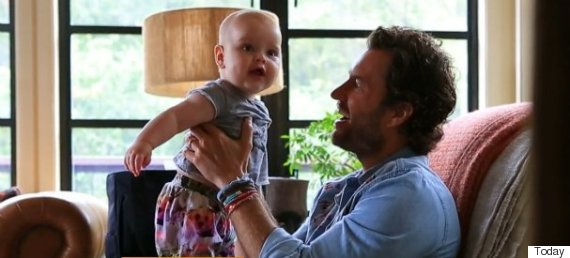 Blake Mycoskie and his 6-month-old son Summit