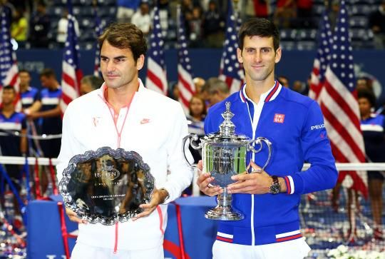 Novak Djokovic (right) says he got parenting advice from fellow tennis champ Roger Federer. (Image: Clive Brunskill/Getty Images)