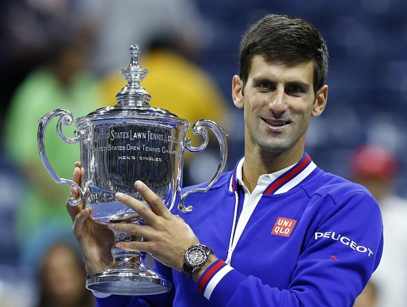Novak Djokovic holds the US Open Trophy after his victory over Roger Federer. (Image: Kena Betancur/Getty Images)