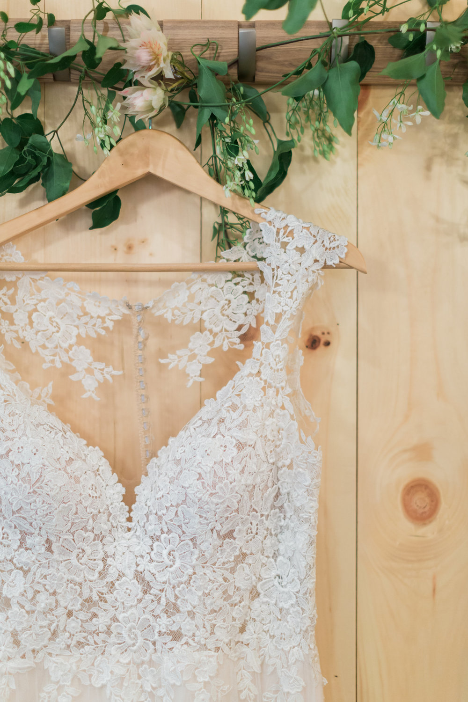 white lace wedding dress photo bride dressing room.jpeg
