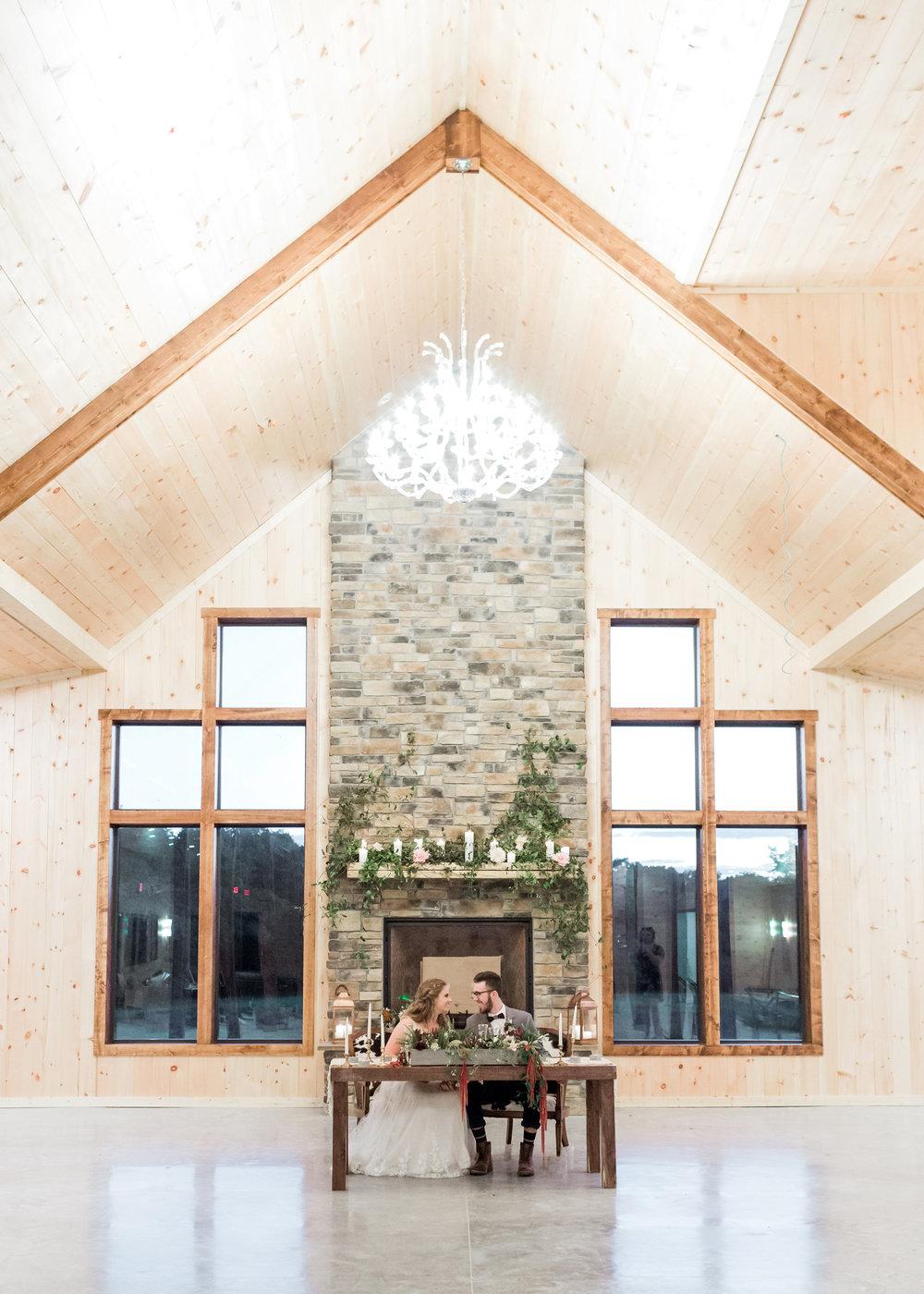 sweetheart-table-chandelier-decor-rustic-boho-reception-country-lane-lodge-adel-iowa