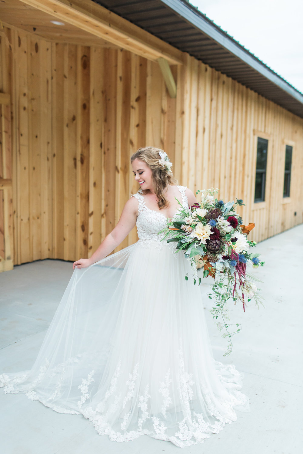 country-lane-lodge-adel-iowa-wedding-venue-white-lace-dress-purple-red-lush-bouquet-planned-by-mostly-becky-weddings