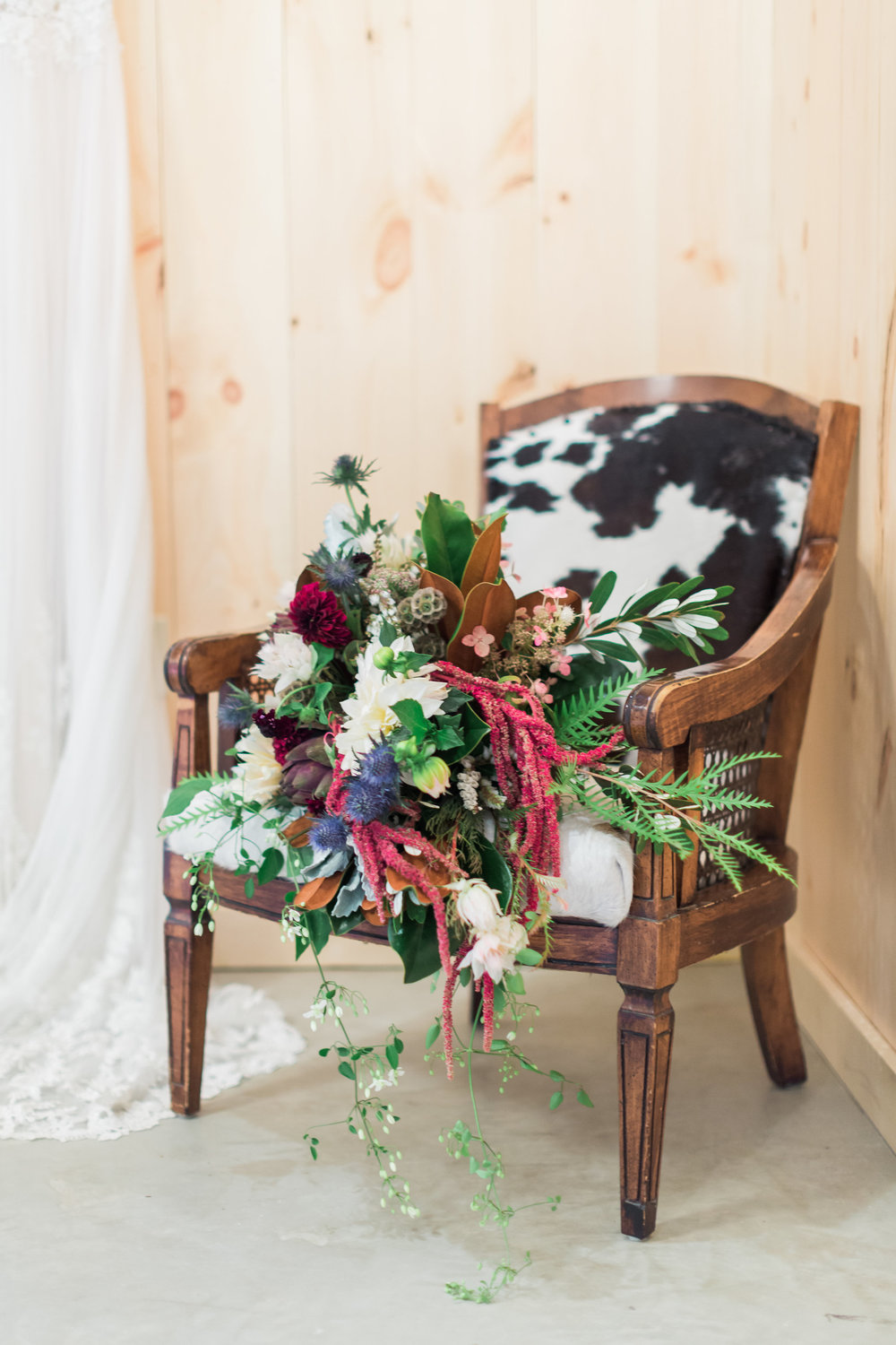 rustic-purple-green-bouquet-cowhide-country-country-lane-lodge-adel-iowa-wedding-venue-iowa-wedding-planned-by-mostly-becky-weddings