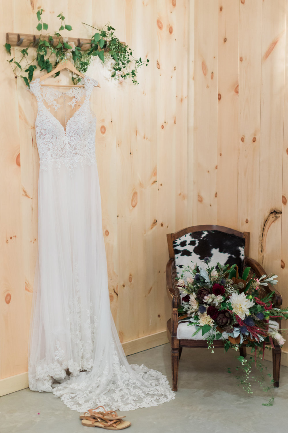 bridal-suite-white-lace-dress-cowhide-vintage-boho-bridal-bouquet-country-lane-lodge-adel-iowa-wedding-venue-iowa-wedding-planned-by-mostly-becky-weddings