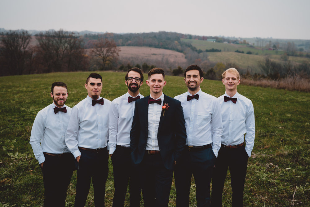 groomsman bowties groom in navy ourdoor bridal party photos.jpg