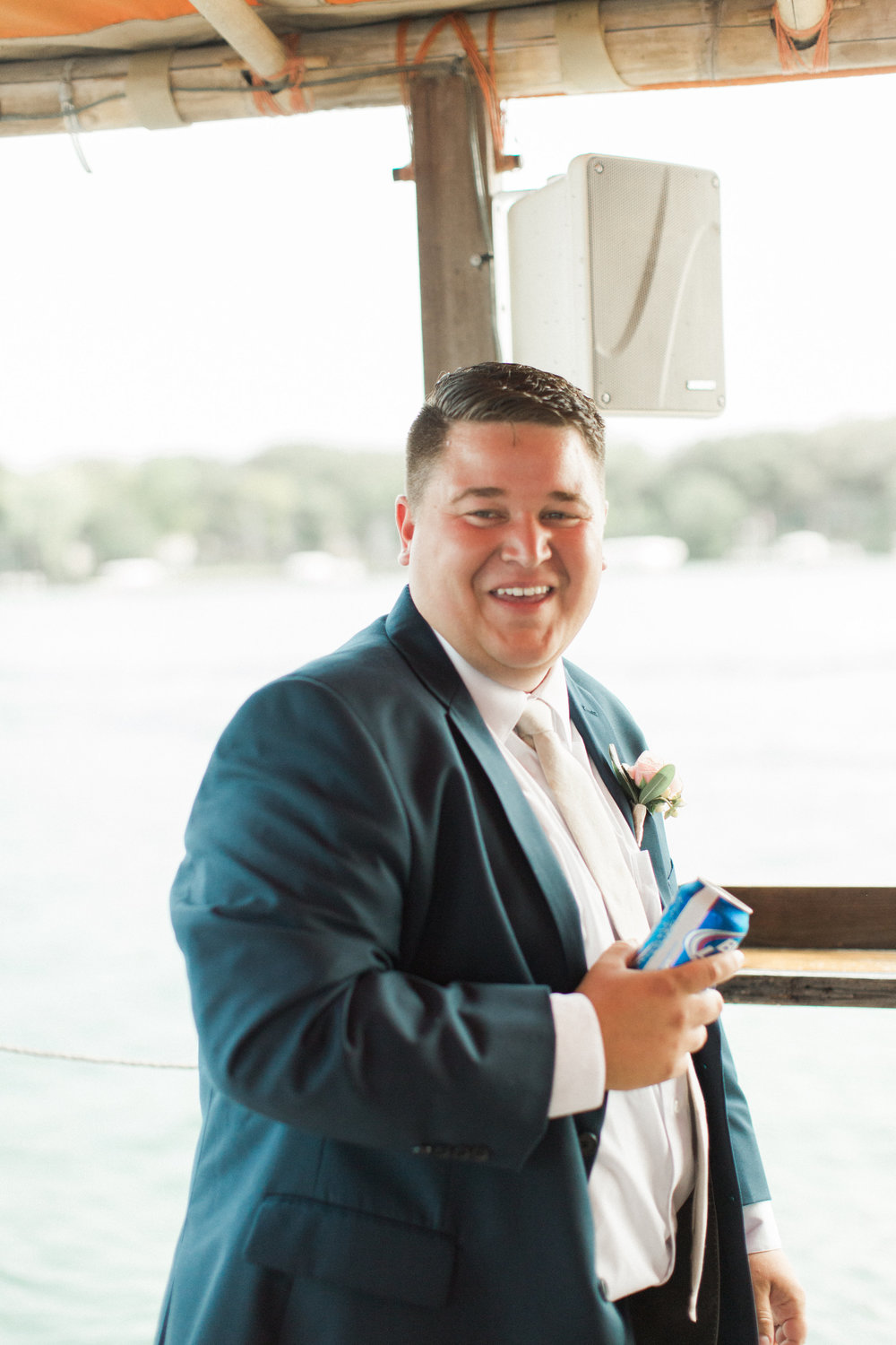 groom-blue-suit-boat-party-bus-okoboji-iowa