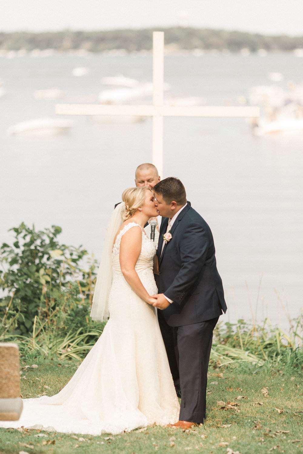 kiss-the-bride-ceremony-photo-lake-view-outdoor-iowa-wedding