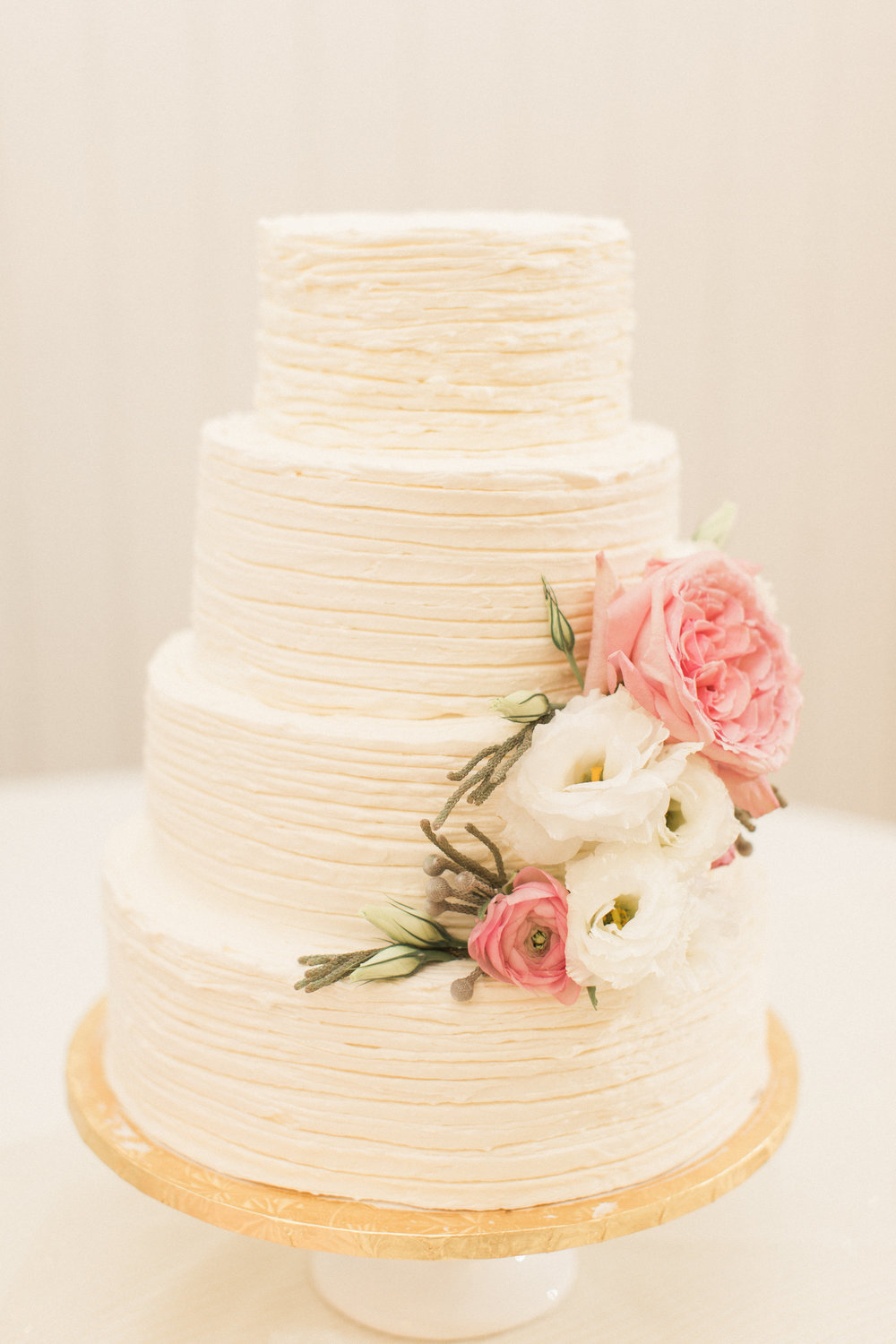 white-three-tier-cake-pink-gold