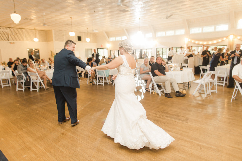 bride-groom-first-dance-iowa-wedding-white-dress-blue-suit