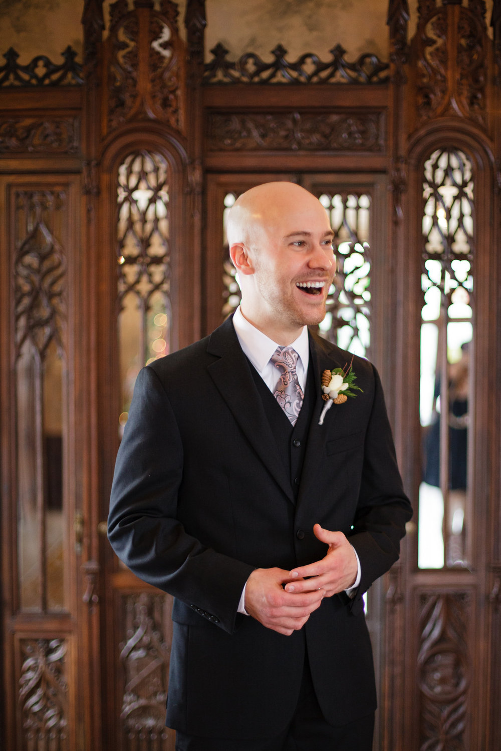 iowa-venue-rollins-mansion-desmoines-iowa-winter-wedding-black-suit