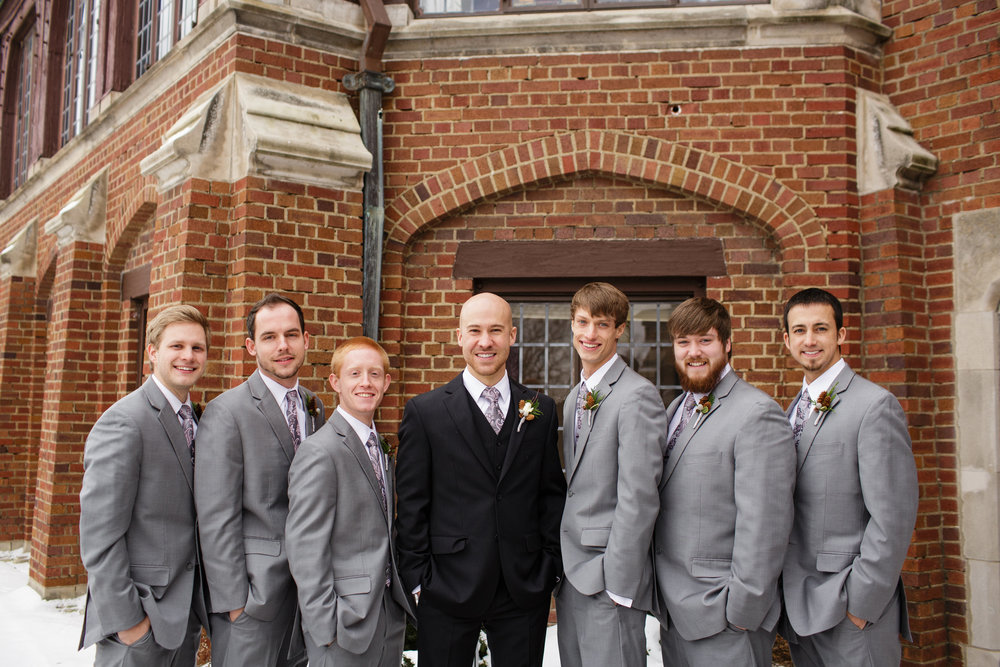Dane rollins-mansion-desmoines-iowa-winter-wedding-gray-groomsman-suits