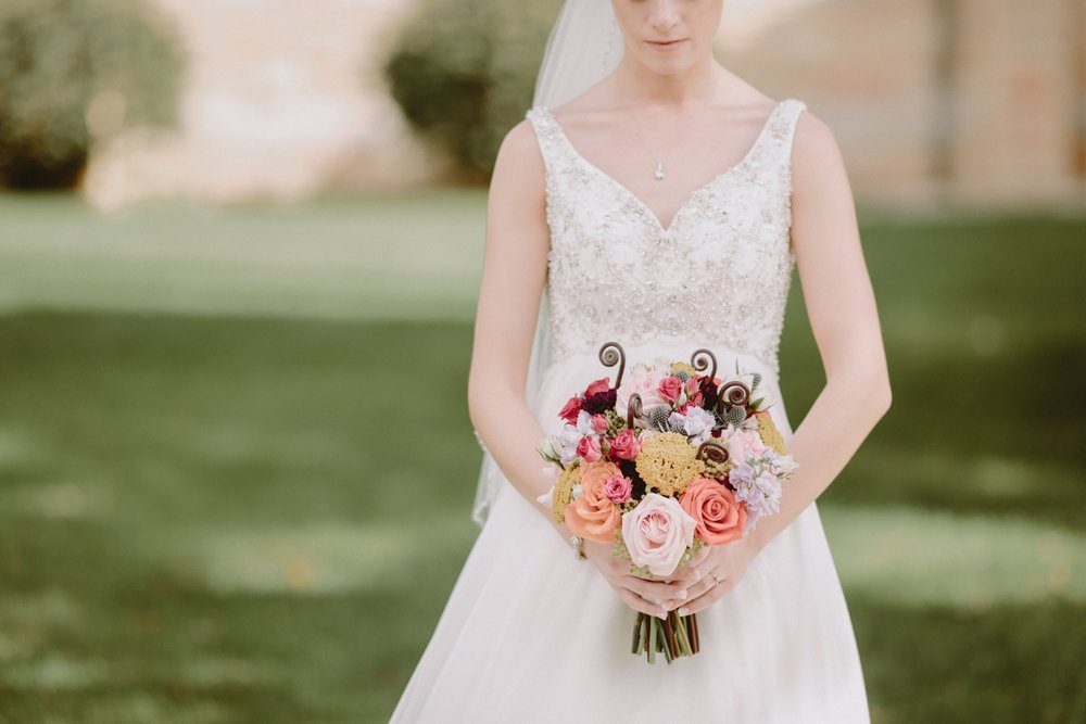 iowa-venue-fort-dodge-church-ceremony-sleeveless-dress-pink-coral-bouquet