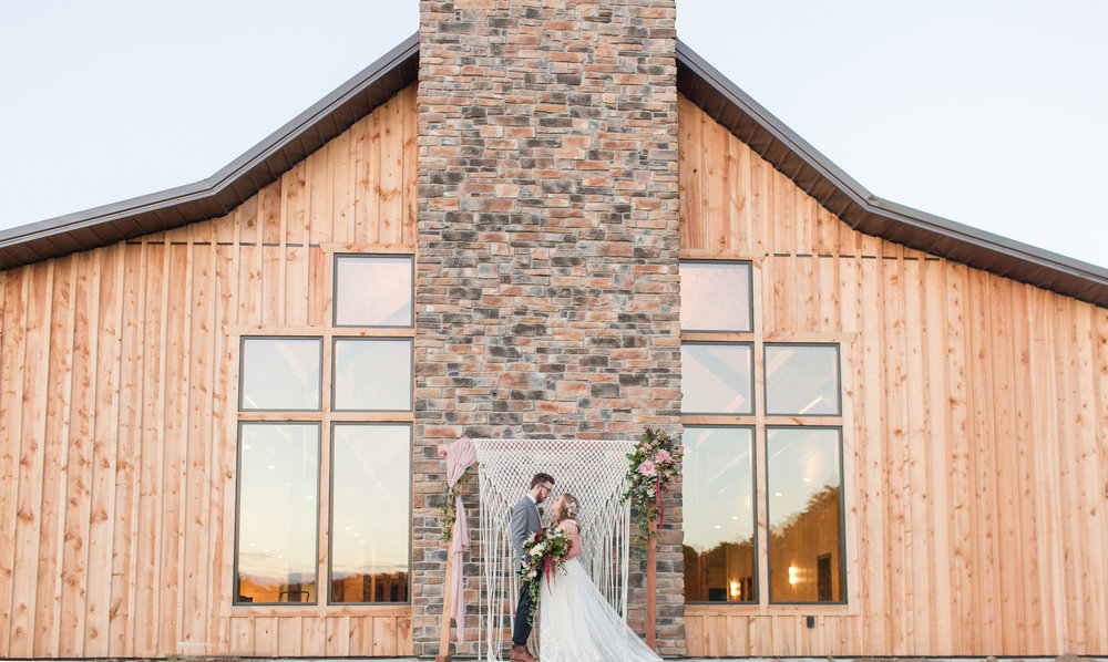 country-lane-lodge-adel-iowa-wedding-venue-white-lace-dress-purple-red-lush-bouquet-planned-by-mostly-becky-weddings-ceremony-floral-decor-lodge-wedding