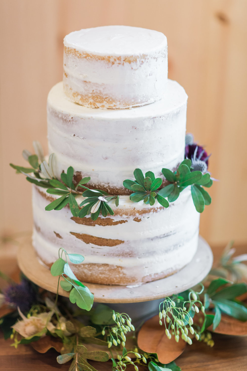 country-lane-lodge-adel-iowa-wedding-venue-white-lace-dress-purple-red-lush-bouquet-planned-by-mostly-becky-weddings-naked-wedding-cake