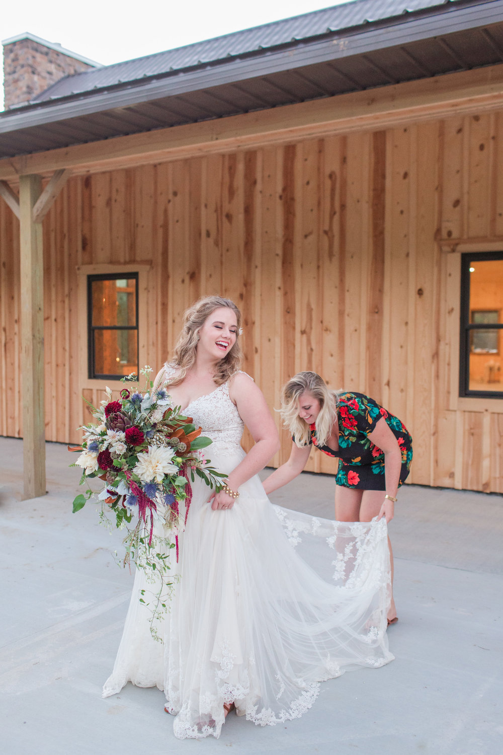 country-lane-lodge-adel-iowa-wedding-venue-white-lace-dress-purple-red-lush-bouquet-planned-by-mostly-becky-weddings-ceremony-lodge-wedding-chandelier-cowhide-sweetheart-table-barn-table-lodge-wedding-mostly-becky-wedding-planner