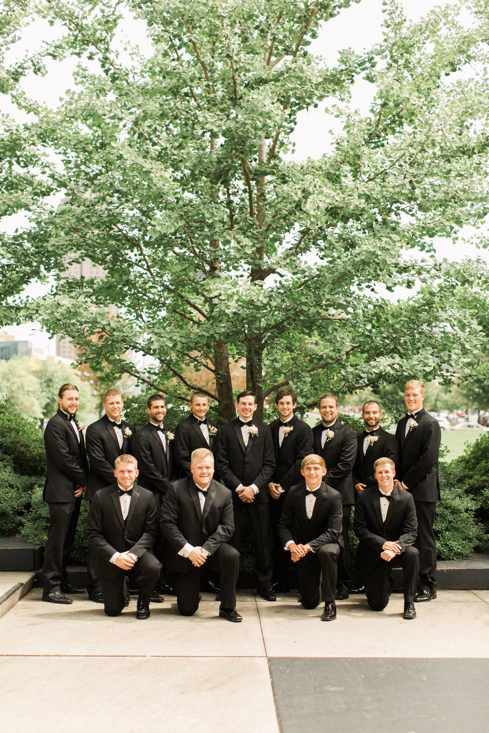 groomsman-iowa-wedding-iowa-venue-blush-white-pink-bridesmaids-dresses-downtown-desmoines-planned-mostly-becky-weddings-outdoor-bridal-party-photos-black-tux-black-tie-event