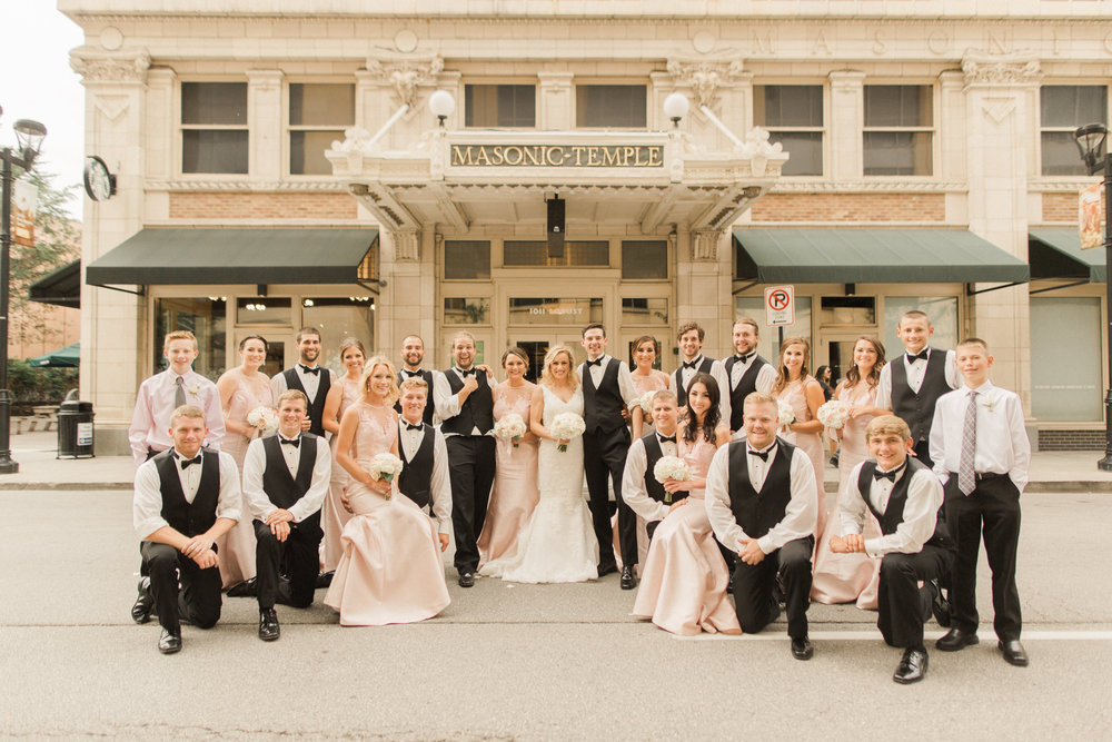 iowa-wedding-iowa-venue-blush-white-pink-bridesmaids-dresses-downtown-desmoines-planned-mostly-becky-weddings-outdoor-bridal-party-photos-black-tux-black-tie-event-bridal-party-photos