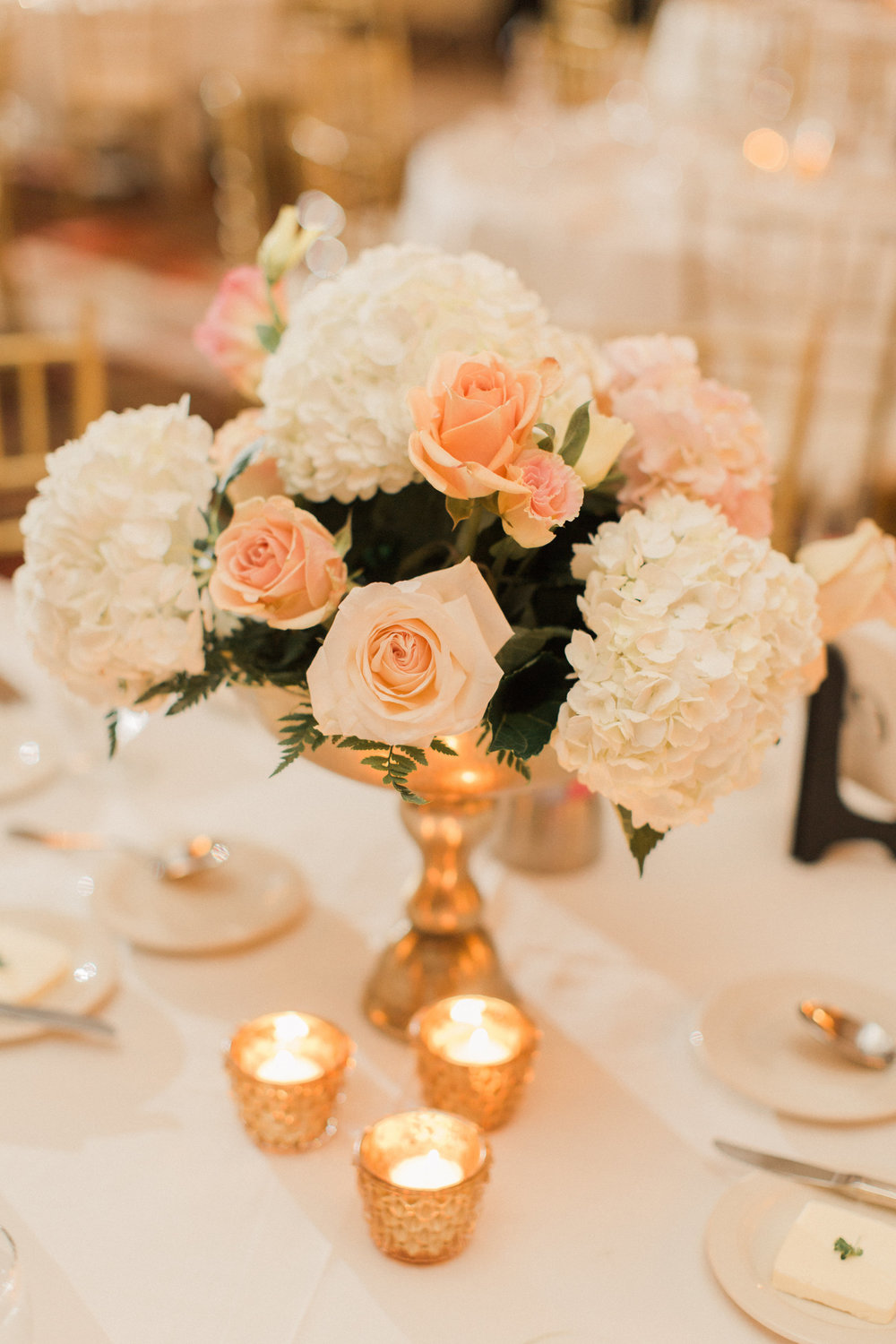 centerpieces-white-flowers-peach-roses-iowa-wedding-iowa-venue-blush-white-pink-bridesmaids-dresses-downtown-desmoines-planned-mostly-becky-weddings-black-tux-black-tie-event