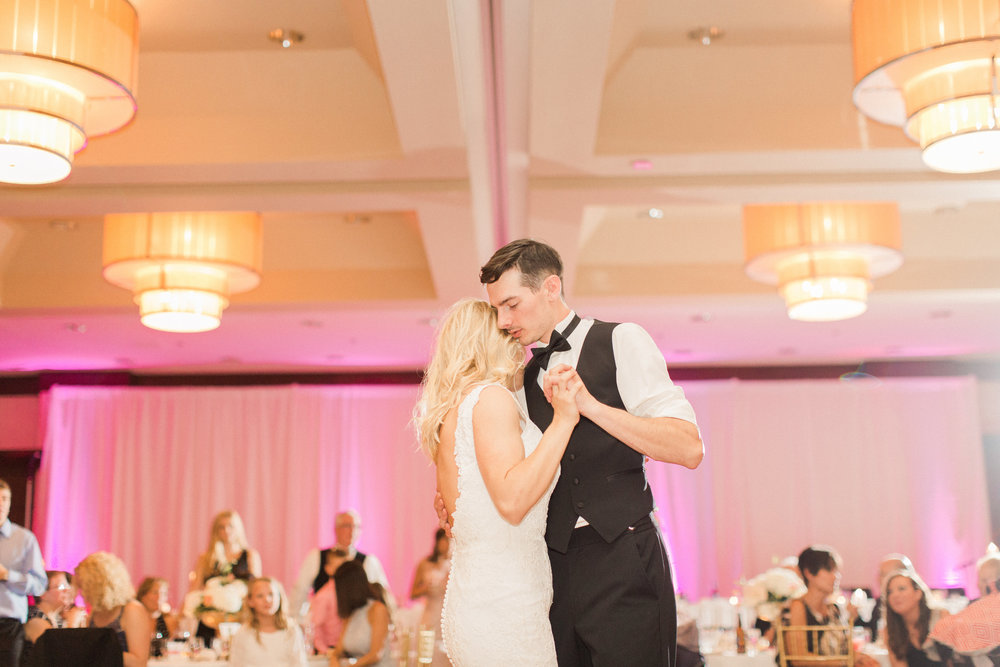 first-dance-ballroom-reception-iowa-wedding-iowa-venue-blush-white-pink-bridesmaids-dresses-downtown-desmoines-planned-mostly-becky-weddings-bridal-photos-black-tux-black-tie-event