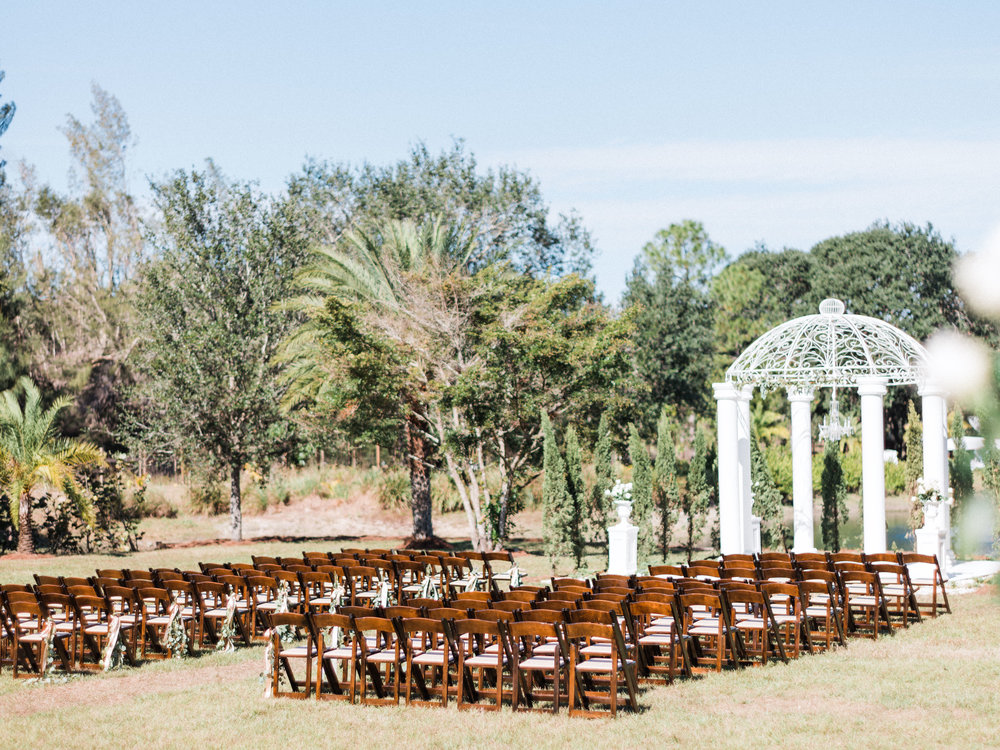 florida-wedding-fort-myers-la-casa-toscana-outdoor-ceremony-winter-wedding-brown-chairs-white-gazebo-planned-by-mostly-becky-weddings-traveling-wedding-planner-destination-wedding