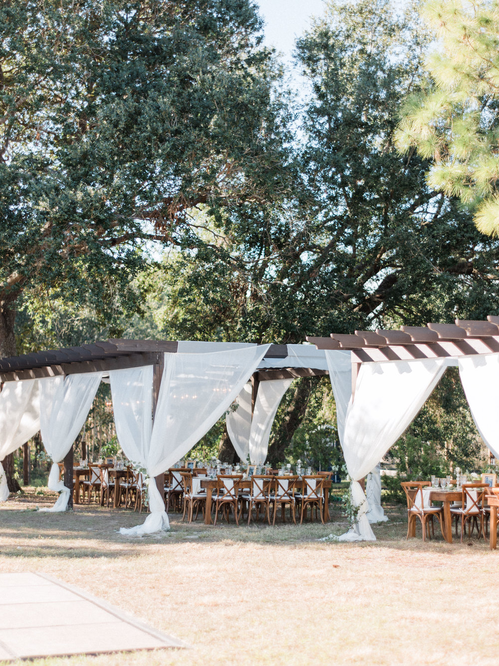 florida-wedding-fort-myers-la-casa-toscana-outdoor-ceremony-winter-wedding-brown-chairs-white-gazebo-planned-by-mostly-becky-weddings-traveling-wedding-planner-destination-wedding-lakeside-bridal-portraits-bride-groom-black-tie-tux-formal-wedding-outdoor-reception-verandas-tuscan-wedding