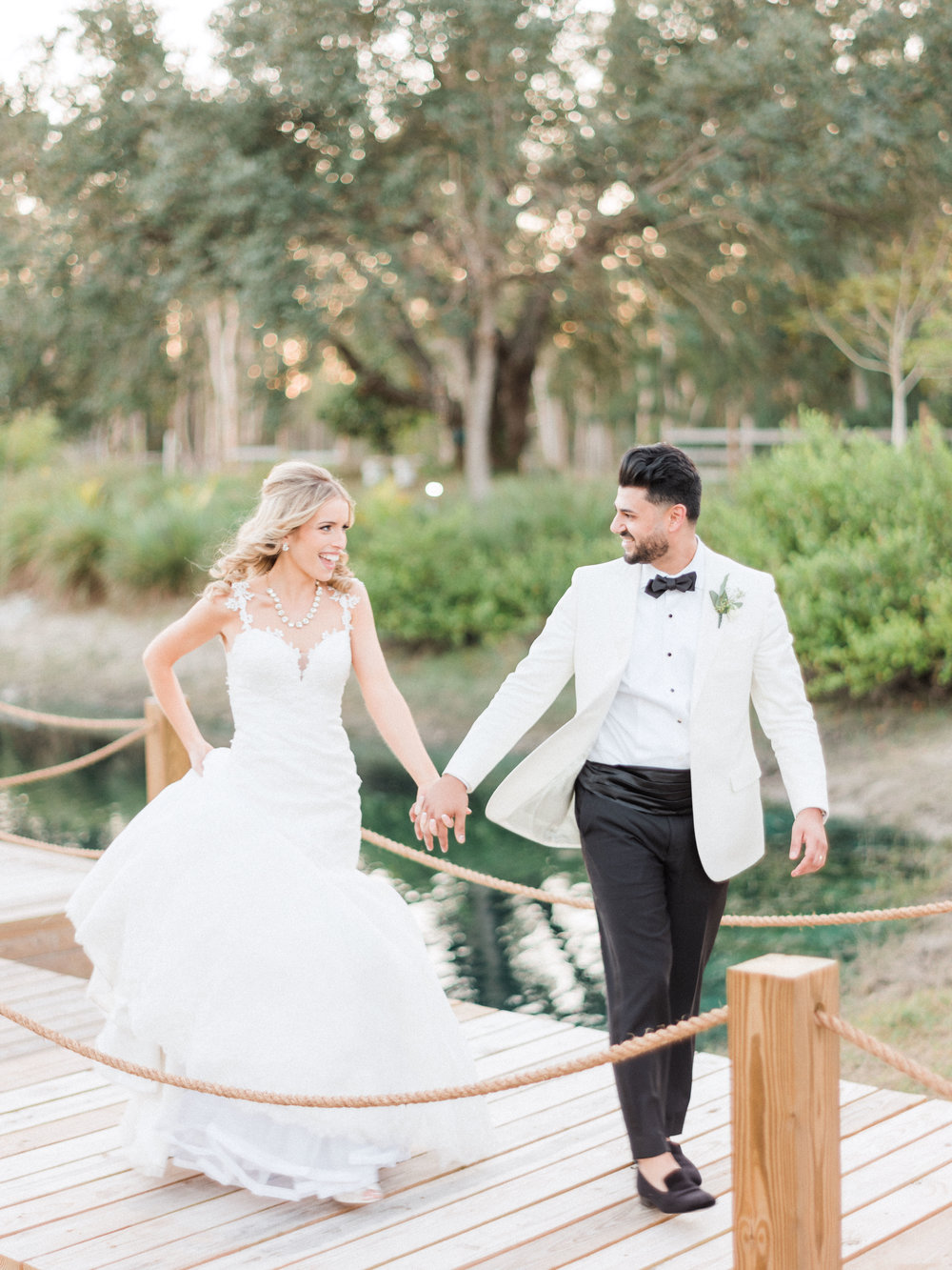 first-look-florida-wedding-fort-myers-la-casa-toscana-outdoor-ceremony-winter-wedding-brown-chairs-white-gazebo-planned-by-mostly-becky-weddings-traveling-wedding-planner-destination-wedding-lakeside-bridal-portraits-bride-groom-black-tie-tux-formal-wedding