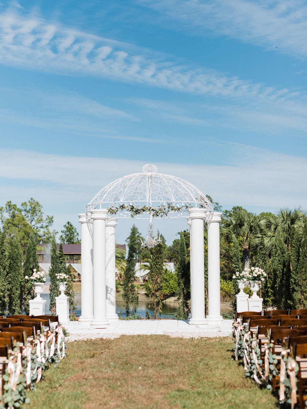 florida-wedding-fort-myers-la-casa-toscana-outdoor-ceremony-winter-wedding-brown-chairs-white-gazebo-planned-by-mostly-becky-weddings-traveling-wedding-planner-destination-wedding-lakeside-bridal-portraits-bride-groom-black-tie-tux-formal-wedding