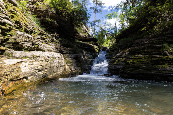 Devils Bathtub located on Spearfish Canyon is known for the rock water slide into a pool of refreshing water. A moderate level hike good for all ages and even dogs!  Photo By: Ryan Clayton