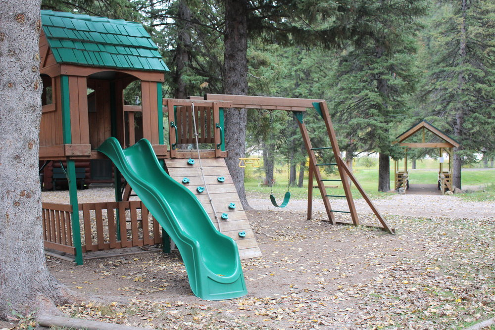 A playground is centrally located for all kids to enjoy.  2 swings, monkey bars and a slide keep the little ones entertained for the days you just want to hang at Wickiup.