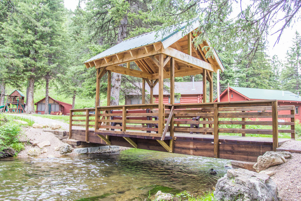 Our covered bridge is a popular spot for anyone wanting to fish, take photos or simply sit and enjoy the scenery.  2 benches and a newly installed chandelier creates a relaxing spot.