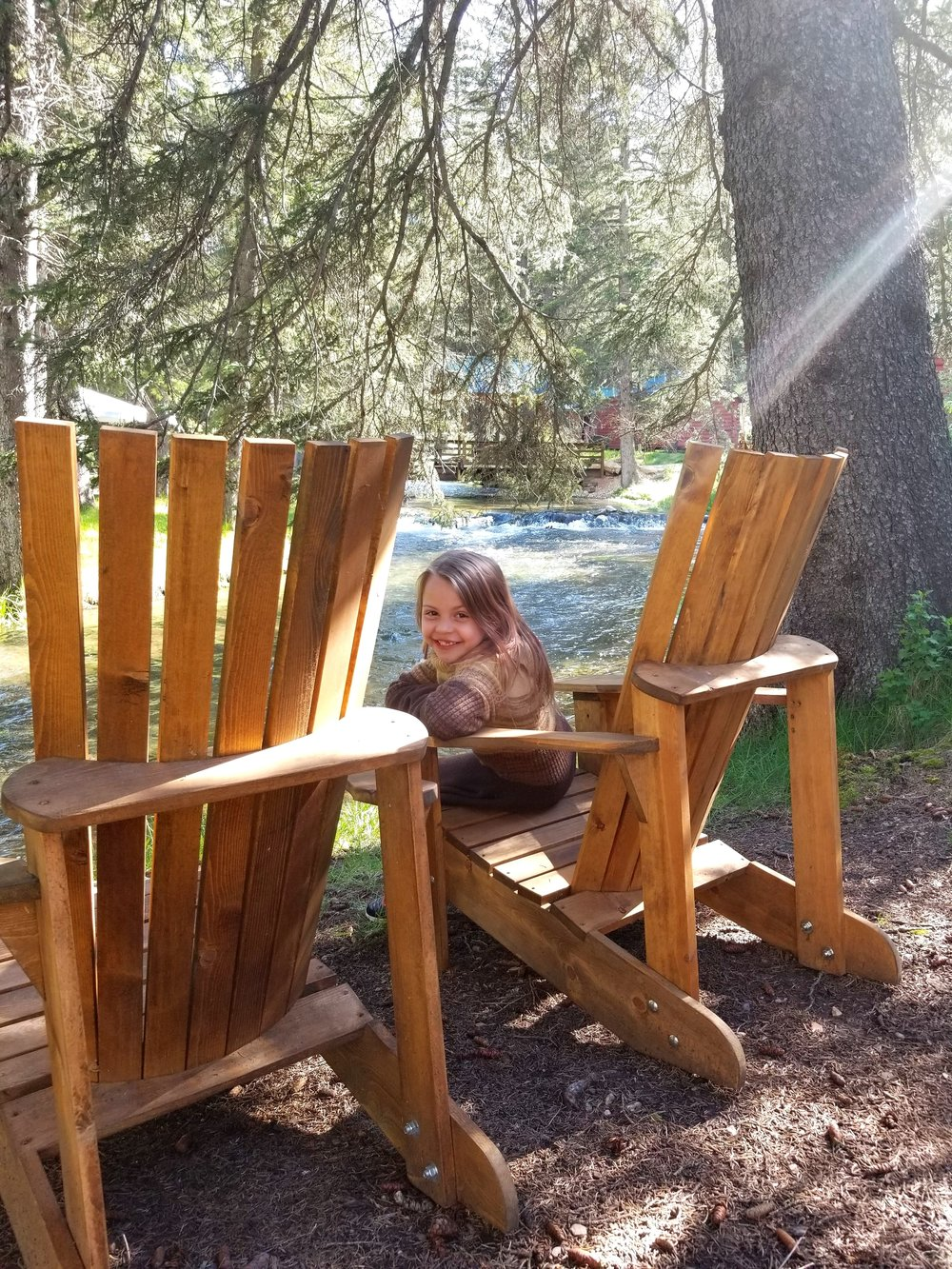 Enjoy creek side views in our Adirondack chairs.  These chairs are supplied at every cabin and made right here in South Dakota by a local friend and guest of Wickiup.  With wide arm rests, they are perfect for setting down a cool beverage and watching the fish go by.