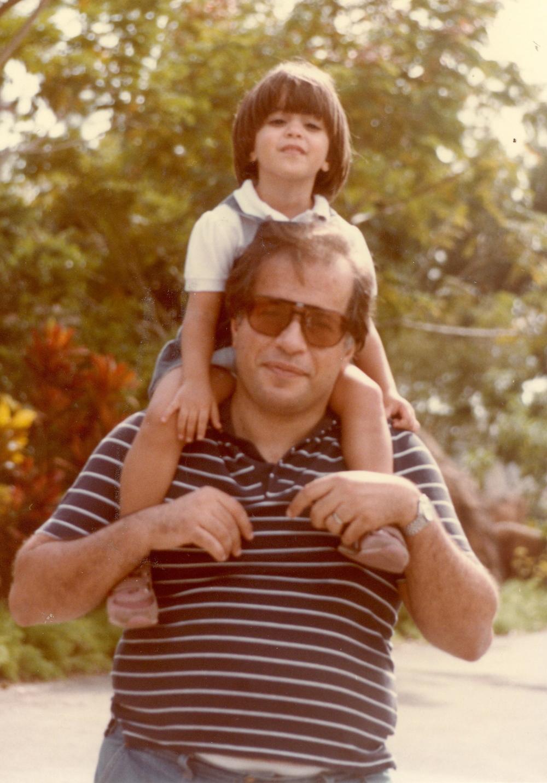 soula on dad's shoulders.JPG