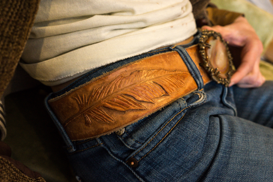 Linny's belt with tooled feather design.