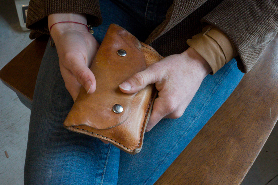 Built to last: Linny's wallet with snaps. The leather is beautifully worn after years of use, soft and supple.
