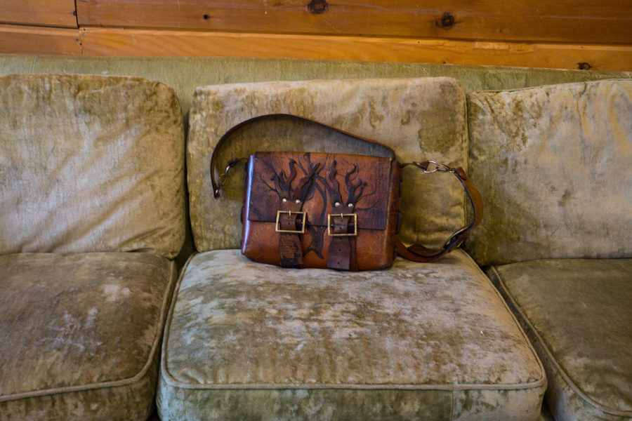 Linny's personal bag with burnt in tree design and her studio couch (best napping couch award!).