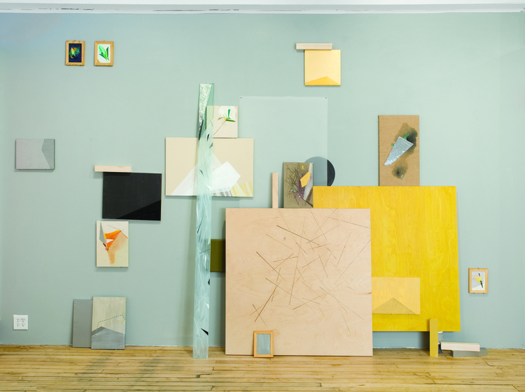 Installation view of   Constructing an Evolutionary System,   2011, Collaged acrylic, frames, glass, and wood on canvas, panel and glassine, 15 x 8.5 ft.