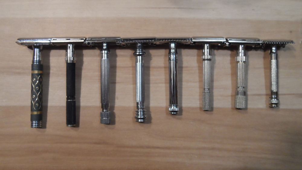 Comparison of the Merkur 38C Long Handle to other razors. The 38C is the 4th razor from the left between the Parker 82R and the Edwin Jagger DE89. From left to right: Parker 65R, Gillette Black Beauty, Parker 82R, Merkur 38C, EJ DE89, Gillette Slim, Gillette FatBoy, and Gillette Old Type OC with Ball End Handle.