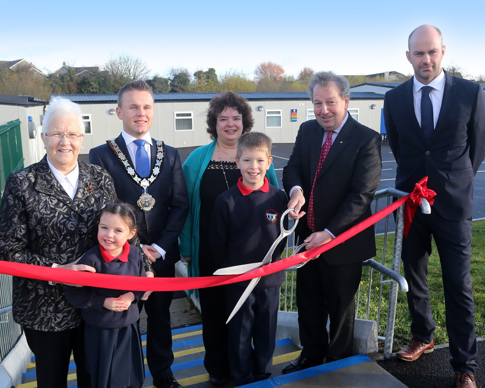 South Antrim MP Danny Kinehan is joined by P1 pupil Mia Carson and P7 pupil Daniel McPherson as he cuts the ribbon to mark the official opening of the new extension at Maine Integrated Primary School in Randalstown. Included are Baroness Blood, Mayor of Antrim & Newtownabbey Cllr Thomas Hogg, Chairperson of the Board of Governors Dianne Mallon and school principal Mr Costello. INBT 48-120JC
