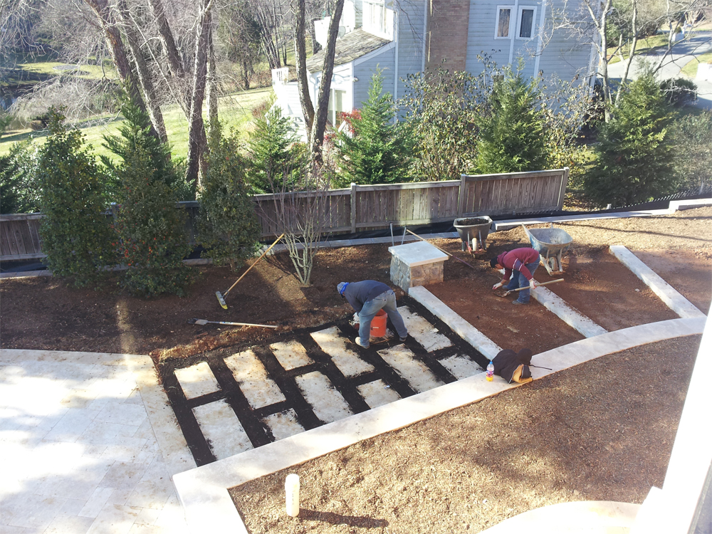 Installation of travertine steppers and adjacent landscaping
