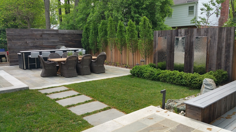 Chrome fountainsline path between outdoor dining and fire-pit patio.